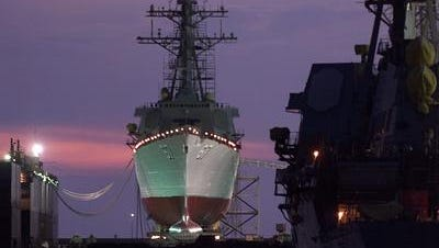The U.S.S. Cole (DDG 67) sits on a floating drydock at Northrup Grumman Ship Systems Ingalls Shipyard in Pascagoula, Miss., Monday, Sept. 3, 2001. Ingalls officials say the Aegis destroyer will be prepared for a Sept. 15, 2001, launch. Once on the water, Ingalls will continue work on the repairs for delivery to the Navy next spring. The ship arrived at Ingalls on Dec. 13, 2000, from Aden, Yemen, and was moved on land where she has remained during the restoration. The Navy destroyer was damaged last October by a terrorist bomb in Yemen. The blast killed 17 U.S. sailors.