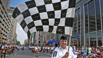 The Indianapolis 500 Gordon Pipers performed at the IPL 500 Festival Parade.