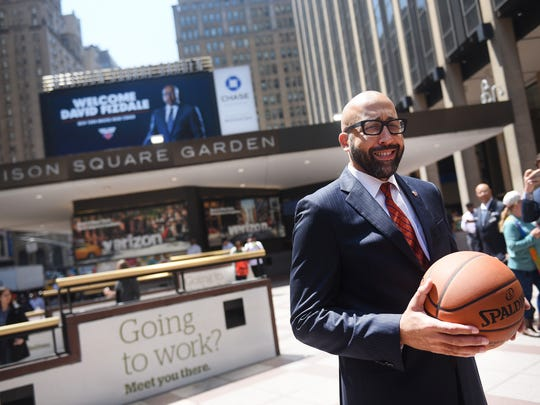 Following a press conference, Knicks new head coach David Fizdale poses for photos with his image shown on a billboard in the background outside of Madison Square Garden in New York  on 05/08/18.