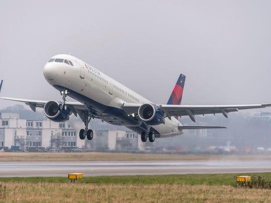 A Delta A321 landing at an airport.