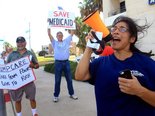 Isabel Araiza shouts with other protesters outside