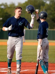 Siegel's Zac Pearson (6) celebrates his home run with Sean Lyons (19) during the first game against Stewarts Creek in the District 7-AAA tournament championship game Wednesday.