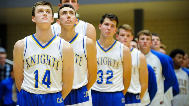 Members of the Castle boys basketball team stand and look at the American flag during the national anthem before their game against Boonville at Castle High School in Newburgh, Tuesday, Nov. 29, 2016.]