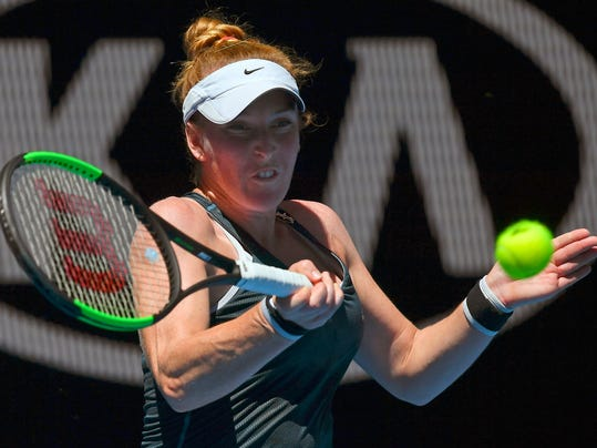 """FILE - In this Jan. 16, 2018, file photo, United States' Madison Brengle makes a forehand return to Britain's Johanna Konta during their first-round match at the Australian Open tennis championships in Melbourne, Australia. Brengle has filed a lawsuit in Florida state court against the WTA and International Tennis Federation, seeking unspecified damages for """"physical and emotional consequences"""" related to anti-doping blood tests. (AP Photo/Andy Brownbill, File)"""