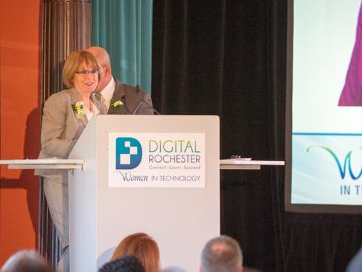 Anne Bell accepts Digital Rochester's Technology Woman of the Year award.