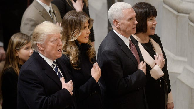 President Donald Trump, First Lady Melania Trump, Vice President Michael Pence and his wife Karen Pence attends the National Prayer Service at the Washington National Cathedral in Washington, D.C., January 21, 2017.