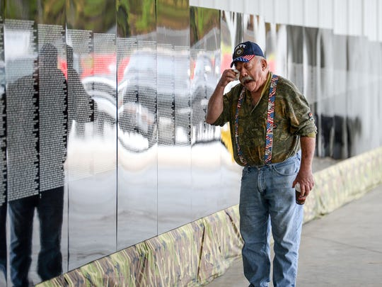 "Kim Blue of Fair Play, retired U.S. Navy, wipes a tear from his eye walking by names of more than 58,000 on the ""The Moving Wall"" half-size replica of the Washington, DC Vietnam Veterans Memorial on display at the Blue Ridge Electric Cooperative building in Westminster. The display can be seen through Monday, from10 a.m. to 5 p.m., and from 10 a.m. to 3 p.m. on Monday."