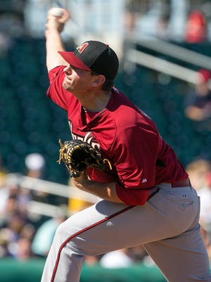 Arizona Diamondbacks pitcher Daniel Hudson throws during a Cactus League game against the Cleveland Indians at Goodyear Ballpark on Friday, March 13, 2015.