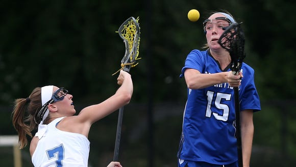 Bronxville's Fiona Jones (right) goes for ball during