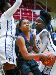 Smyrna's Keisha Brady drives through traffic during Thursday's game at the State Farm Classic.