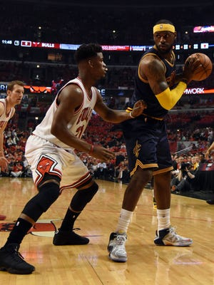 The Bulls' Jimmy Butler always matches up against the opponent's best player, including the Cavaliers' LeBron James.