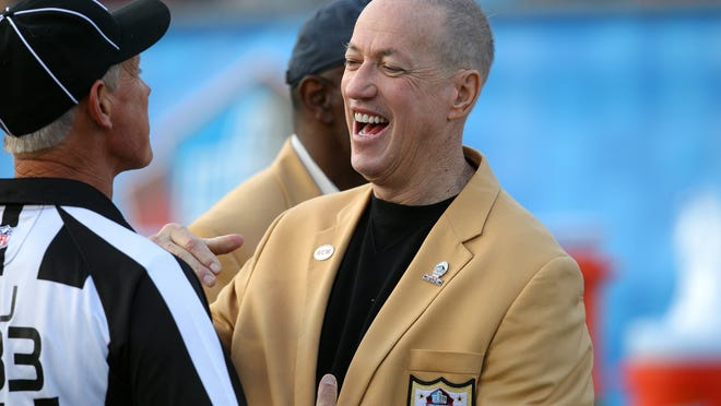 Buffalo Bills great Jim Kelly shares a laugh before his duties as the honorary captain for the Hall of Fame game between the Bills and the New York Giants.