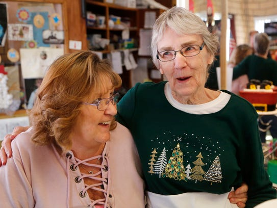 Owner Judy Lintner, left, and Mary Freitag a laugh