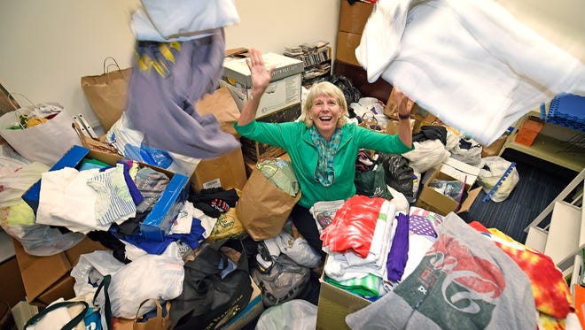 Ms. Cheap has collected a bunch of t-shirts for Room in The Inn. Guess how many were donated.