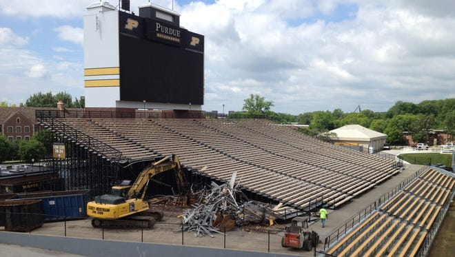 Work on tearing out the bleachers