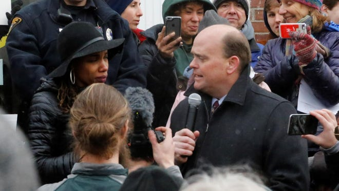 Rep. Tom Reed met with Ithaca constituents at a town-hall meeting March 11, and even chatted with those gathered outside.