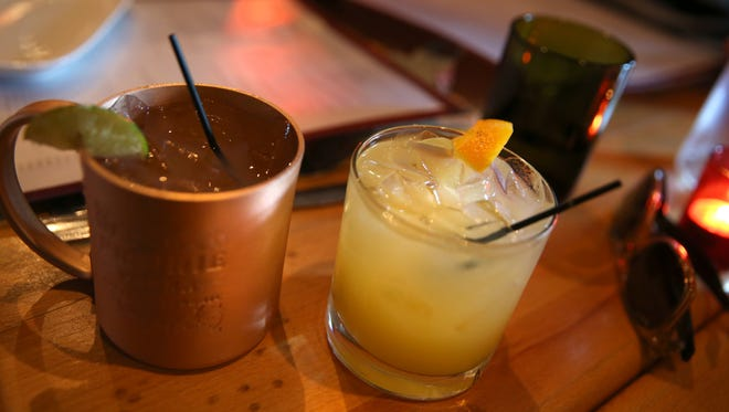 A Moscow Mule, left, and a JoJo Wedge, featuring Citrus Vodka, Fresca and a hint of grapefruit juice, served up at JoJo Bistro and Wine Bar.