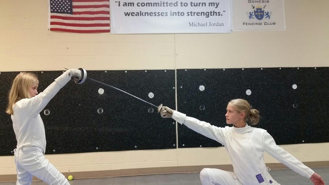Rebekah Bucur, right, 13, sparring with her younger sister, Naomi, will be fencing in the tournament to benefit the March of Dimes.