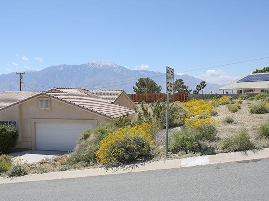 A home is for sale, left, in a neighborhood overlooking the city on Redbud Rd. in Desert Hot Springs.