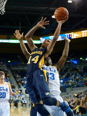 Drexel guard Damion Lee, left, puts up a shot as UCLA center Tony Parker defends during a game Nov. 8, 2013, in Los Angeles.