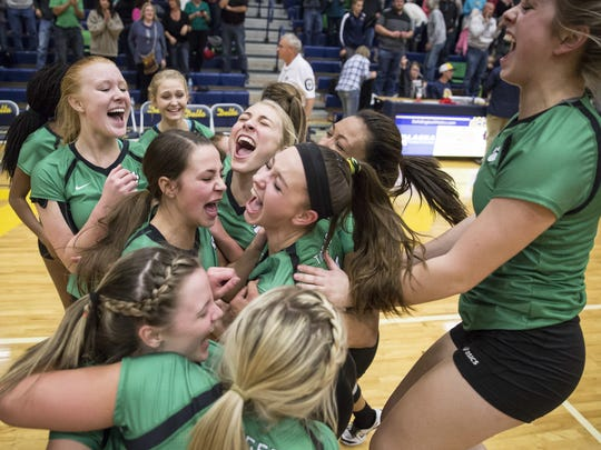 Corey Ohlenkamp/The Star Press Yorktown's team celebrates on the court Saturday after a win during sectional finals. Yorktown's team celebrates on the court Saturday after a narrow win during sectional finals. Yorktown won won the fifth set 19-17 and defeated Delta 3-2.