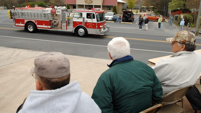 Dignitaries watch the parade as Millville Fire Company celebrated their 75th Anniversary of community service with a parade and ceremony at the fire station in Millville on Saturday April 16th.