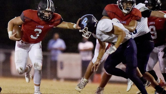 Augusta Christian's Zack Blackwell stiff arms a Pinewood defender as he picks up some yardage during football action at Augusta Christian in Martinez, Ga., Friday evening October 9, 2020