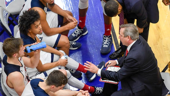 University of Southern Indiana head coach Rodney Watson talks to his team during a time out as the USI Screaming Eagles play the Bellarmine Knights at USI's Physical Activities Center Saturday, February 10, 2018.