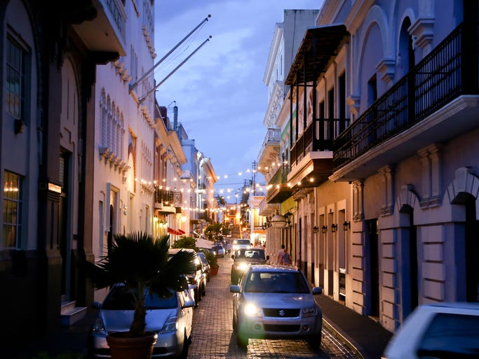 Traffic navigates the cobblestone streets of Old San Juan in the early hours of the evening. The island of Puerto Rico is reeling from a bad economic outlook and high unemployment rates.