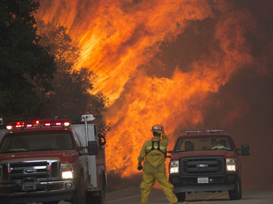 Firefighters are forced to retreat as flames close in on them in Placerita Canyon at the Sand Fire on July 24, 2016, in Santa Clarita, Calif. Firefighters in California and across the country rely on timely and consistent weather data to understand fire behavior.
