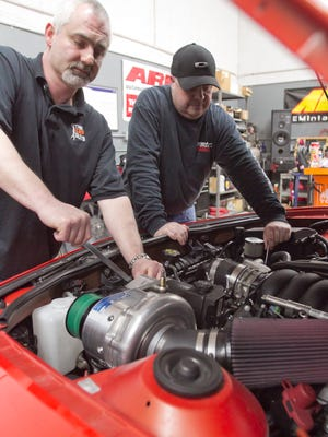 The Car Guys director of operations Dan Sienkiewicz, left, and Kelley Longwish, general manager of Vector Motorsports share a love of performance automobiles and racing.