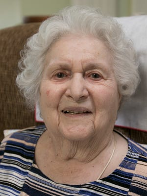 Margaret Gordon, 100 years old on March 22, recalls a lifetime of family memories while talking to the Livingston Daily Monday, March 19, 2018.