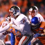 Fresno State quarterback Brian Burrell (2) throws a pass under heavy pressure from Boise State linebacker Tyler Gray (36) earlier this season.