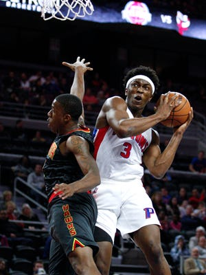 Pistons forward Stanley Johnson (3) shoots the ball as Hawks guard Lamar Patterson (13) defends during the first quarter of the Pistons' preseason win Friday at the Palace.