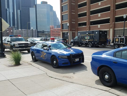 Police cruisers line Atwater street as GM's Israel@70