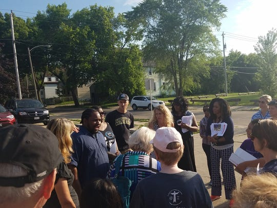 Milwaukee activist Tory Lowe talks to volunteers at the end of the search for a missing Glendale teen.