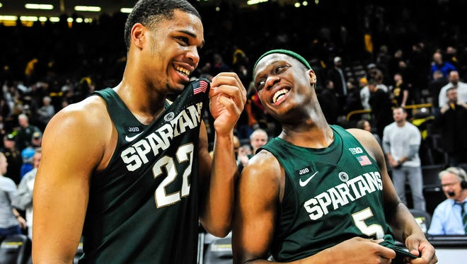 MSU's Miles Bridges, left, and Cassius Winston celebrate after beating Iowa 96-93 late Tuesday night in a closer-than-expected game.