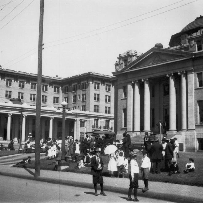 "Alexandria City Hall (building at right) is shown in this photo from the early 1900s. At left is the Hotel Bentley. Scenes like this one are featured in ""Central Louisiana: 100 Years of Photographs & Illustrations,"" a two-DVD set that goes on sale next Tuesday to raise funds for the Louisiana History Museum in Alexandria."