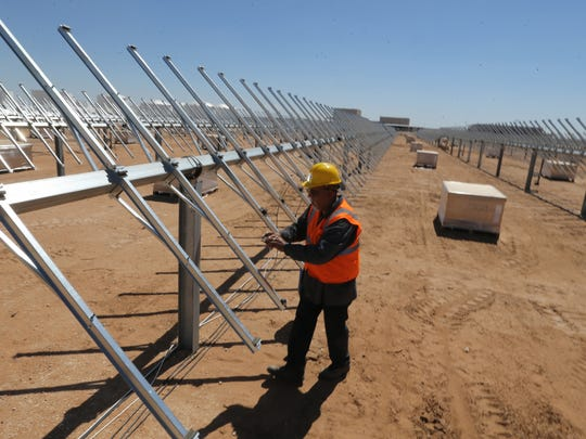Raymundo Hernandez positions hardware in preparation for the installation of solar panels at El Paso Electric's community solar plant under construction in far East El Paso County.