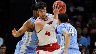 Mar 26, 2015; Los Angeles, CA, USA; Wisconsin Badgers forward Frank Kaminsky (44) controls the ball against North Carolina Tar Heels guard/forward Justin Jackson (44) during the first half in the semifinals of the west regional of the 2015 NCAA Tournament at Staples Center. Mandatory Credit: Robert Hanashiro-USA TODAY Sports