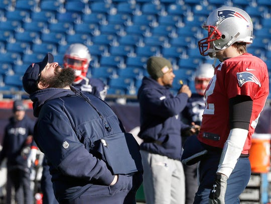Patriots defensive coordinator Matt Patricia, left,