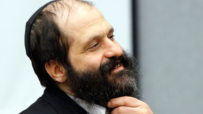 In this June 7, 2010, file photo former Agriprocessors executive Sholom Rubashkin appears at the Black Hawk County Courthouse in Waterloo, Iowa. President Donald Trump on Dec. 20, 2017, commuted the prison sentence of Rubashkin, a Iowa kosher meatpacking executive sentenced to 27 years in prison for money laundering — the first time he's used the presidential power. The decision to intervene on behalf of Rubashkin, who ran the Iowa headquarters of a family business that was the country's largest kosher meat-processing company, came at the urging of multiple members of Congress and other high-ranking officials who argued Rubashkin's sentence was too harsh, the White House said.