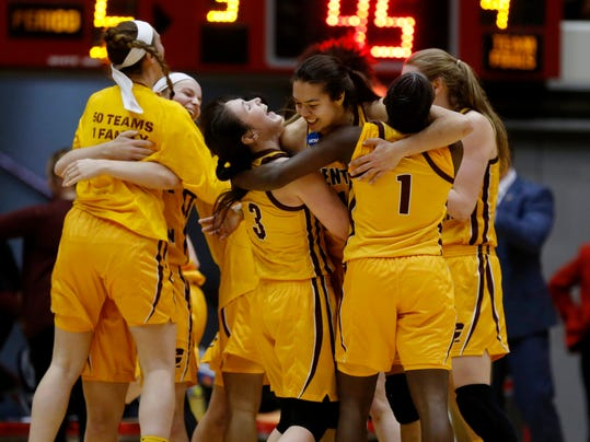 Members of the Central Michigan basketball team celebrate a second-round game victory over Ohio State in the NCAA women's college basketball tournament in Columbus, Ohio, Monday, March 19, 2018. (AP Photo/Paul Vernon)