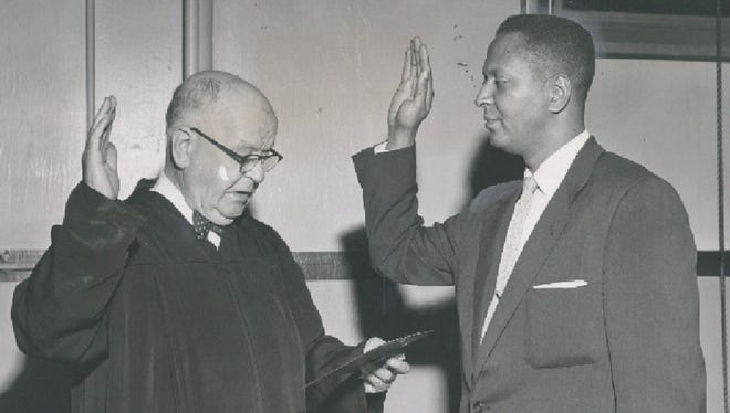 Benjamin F. Shobe is swarn in as an assistant to Commonwealth's Attorney A. Scott Hamilton. The oath was administered by Circuit Judge L. R. Curtis. 1956