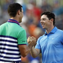 Sep 13, 2014; Atlanta, GA, USA; Billy Horschel (left) and Rory McIlroy (right) shake hands on the eighteenth green during the third round of the Tour Championship at East Lake Golf Club. Mandatory Credit: Brett Davis-USA TODAY Sports
