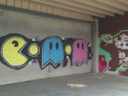 Pac Man mural shown before it was tagged.