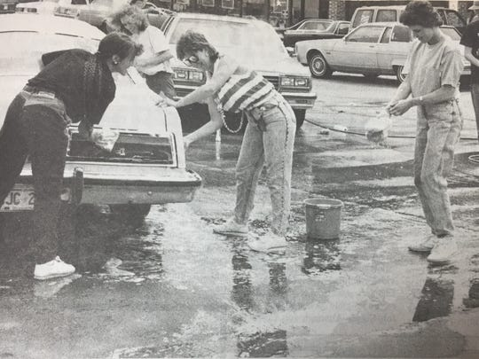 Wal-Mart associates spent a Friday washing cars for the Children's Miracle Television Network in May 1989. Pictured from the left are Jennifer Buckman, Sherri Lewis, Jama Lyon, Paula Pogue, and Kevin Rash.