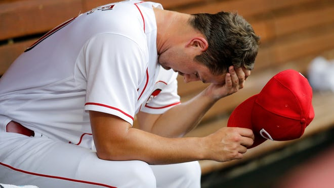Cincinnati Reds starting pitcher Tyler Mahle (30) wipes his head in the dugout after leaving the game in the top of the second inning of the MLB National League game between the Cincinnati Reds and the Philadelphia Phillies at Great American Ball Park in downtown Cincinnati on Thursday, July 26, 2018. The Reds trailed 4-2 after three innings.