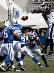Rams middle linebacker Alec Ogletree, right, blocks a pass attempt by Colts quarterback Scott Tolzien during the Rams' rout of the Colts last Sunday.