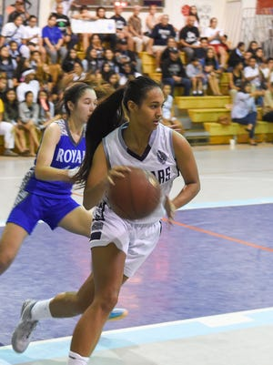 Kali Benavente (3) of the Academy of Our Lady of Guam Cougars takes the ball down court against the Notre Dame Roylas during their Independent Interscholastic Athletic Association of Guam Girls' Basketball League game at the Academy Gym in Hagatna on Nov. 23.